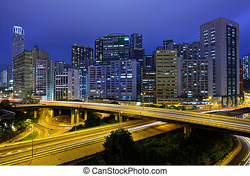 Hong kong downtown with traffic at night