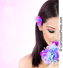 Spa concept - Beautiful young female portrait, hand holding...