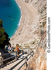 People go to the beach of Platia Amos - Kefalonia