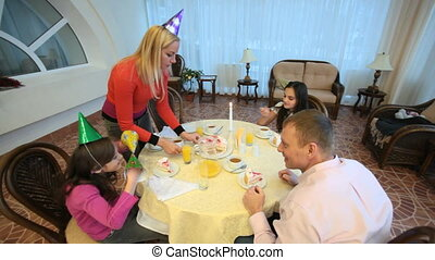Eating cake at table - Family of four eating cake