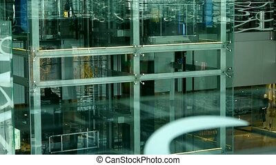 Elevator in Luxury mall glass...