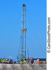 Oil Well - Oil Field Pulling Unit installing new sucker rods...
