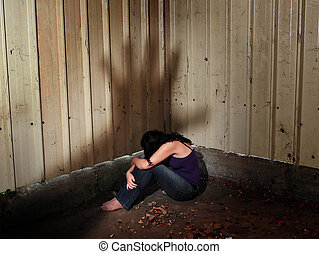 Abused Victim - A woman who is a victim of abuse is hiding...