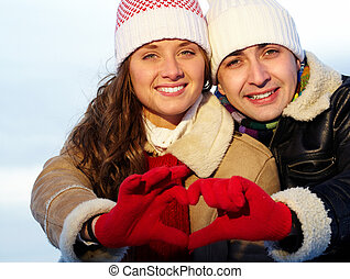 Sweethearts - Portrait of happy couple in warm clothes...