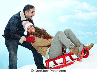 Winter vacation - Portrait of happy couple in warm clothes...