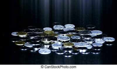 Coin Fall,group of RMB coins and rays light.