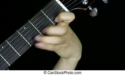 man playing guitar,strum.
