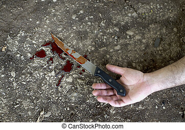 Knife Hand Violence - Conceptual image of a hand holding a...