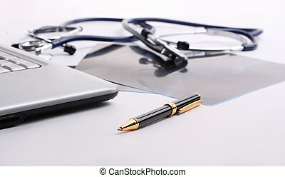 stethoscope with the handle and papers