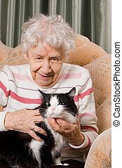 The grandmother with a cat on a sofa - The grandmother with...