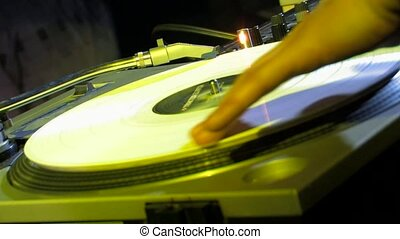 DJ spinning the vinyl in the club