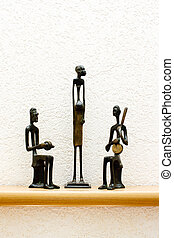 three African figurines - three African statues against the...