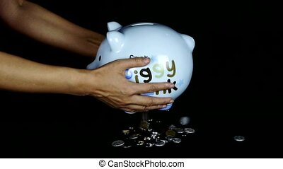 coins falling from Piggy bank in black space