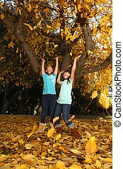 Happy Children With Colorful Fall Leaves Outdoors - Playful...