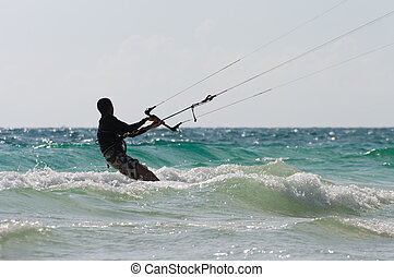 kite surfer in action on the waves