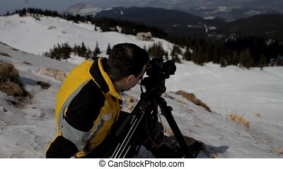 Man taking picture on mountain