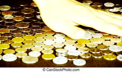 caress golden coins by hand