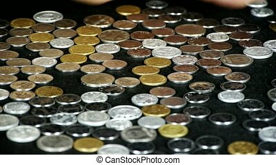 caress golden coins by hand.