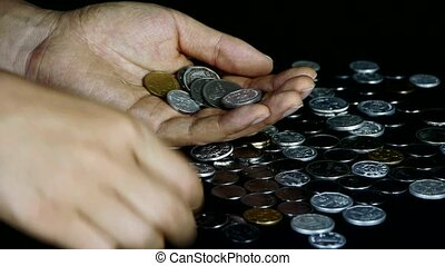 Counting golden coin from a group of money by hand.