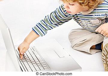 High tech child - Blue hair boy exploring computer