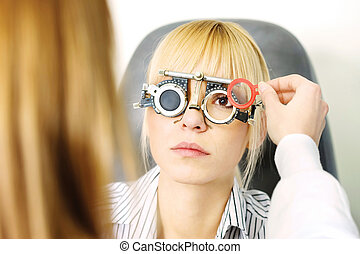 optometrist - Blond female patient on medical attendance at...