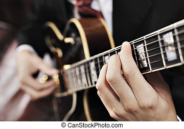 Guitarist - Jazz musician playing with electric guitar Short...