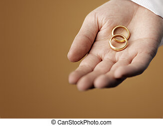 Gold Rings - Man holding 100 year old gold wedding rings in...