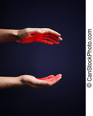Red Glow - Hands of a man with a red glow.