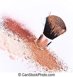 makeup brush and powder