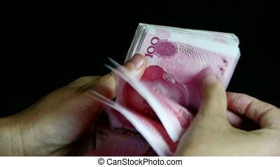 Counting money RMB.
