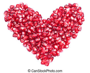 Shape of a heart made out of pomegranate seeds isolated on...