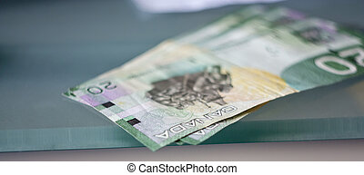 Canadian dollars - Photo of Canadian dollars on the table.