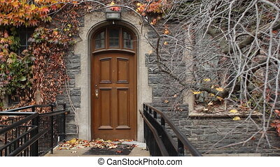 Door. - Wooden door at entrance to brick building. Toronto,...