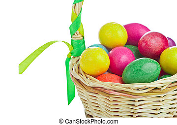 colorful easter eggs in basket - closeup of colorful easter...