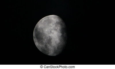 Moon behind cloud