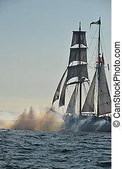 Tall Ships - Tall ship at sea firing cannons