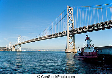 Suspension Oakland Bay Bridge in San Francisco to Yerba Buena Island with fireboat from San Francisco Fire Department