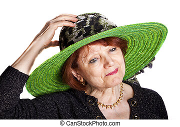 Woman With Green Hat - Elegant senior woman wearing a green...