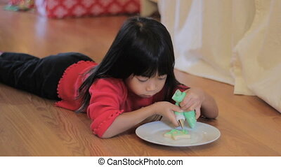 Decorating Christmas Cookie Green - A cute little 5 year old...