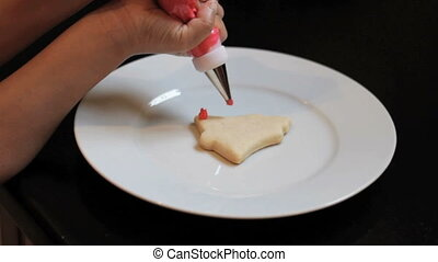 Decorating Christmas Bell Cookie - A little 5 year old girl...