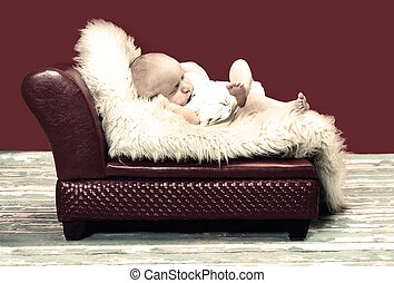 Vintage couch and lazy baby