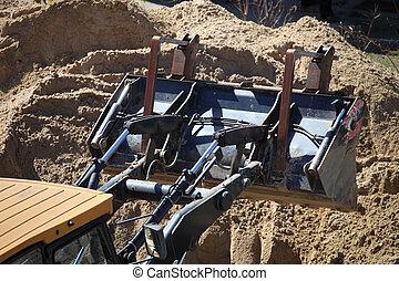 Yellow excavator construction site