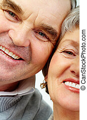 Elderly couple - Faces of senior woman and man face to face...
