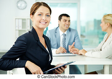Female leader - A beautiful businesswoman looking at camera...