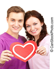 Symbol of love - Portrait of young couple looking at camera...
