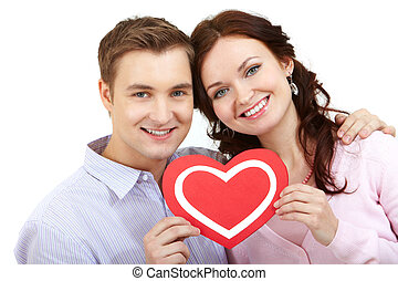 Valentines - Portrait of a young happy couple holding paper...