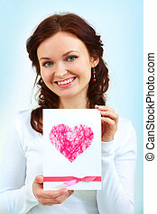 Girl with card - Portrait of a woman holding card with pink...
