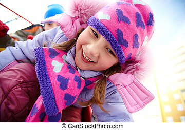 Happy time - Happy girl in winterwear having fun outside...