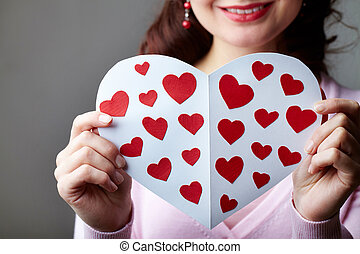 Valentine card - Close-up of female hands holding valentine...