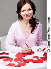Saint Valentines day - Portrait of happy woman signing...